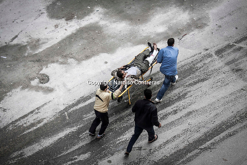 In this Tuesday, Oct. 23, 2012 photo. A Syrian civilian is transfer, through streets, from one hospital to another one in Tarik Al-Bab neighborhood, after he was injured when an attack by mortar shell targeted a bakery in Hananu district at the northeast of Aleppo City. (AP Photo/Narciso Contreras).