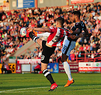 Lincoln City's Matt Green vies for possession with Exeter City's Jordan Storey<br /> <br /> Photographer Chris Vaughan/CameraSport<br /> <br /> The EFL Sky Bet League Two Play Off Second Leg - Exeter City v Lincoln City - Thursday 17th May 2018 - St James Park - Exeter<br /> <br /> World Copyright &copy; 2018 CameraSport. All rights reserved. 43 Linden Ave. Countesthorpe. Leicester. England. LE8 5PG - Tel: +44 (0) 116 277 4147 - admin@camerasport.com - www.camerasport.com