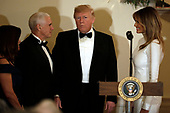 United States President Donald J. Trump with First Lady Melania Trump (R), US Vice President Mike Pence and his wife Karen Pence attend the Congressional Ball at White House in Washington on December 15, 2018. <br /> Credit: Yuri Gripas / Pool via CNP