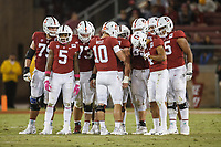 Stanford, CA - October 05, 2019:  Jack West leads the huddle during the Stanford vs Washington football game Saturday night at Stanford Stadium.<br /> <br /> Stanford won 23-13.