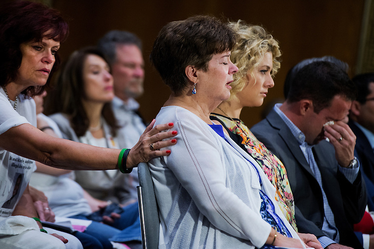 "UNITED STATES - JULY 21: Liz Sullivan, mother of Kathryn Steinle, who was killed by an undocumented man on July 1st., in San Francisco, is comforted by Sabine Durden, left, during a Senate Judiciary Committee hearing in Dirksen Building titled ""Oversight of the Administration's Misdirected Immigration Enforcement Policies: Examining the Impact on Public Safety and Honoring the Victims,"" July 21, 2015. The hearing featured testimony of families of victims who were killed by undocumented immigrants. (Photo By Tom Williams/CQ Roll Call)"