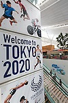 Travellers walk past a Tokyo Paralympic Games advertisement on display at Tokyo International Airport on August 30, 2016, Tokyo, Japan. Between August 24 and October 10 the airport is displaying many Welcome to Tokyo 2020 signs to promote the 2020 Summer Olympic Games. (Photo by Rodrigo Reyes Marin/AFLO)