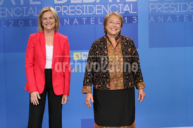 Candidates for President of Chile,  center-leftist  Michelle Bachelet,right, Chile's first female president who governed from 2006 to 2010; and Evelyn Matthei, economist from the more conservative Union Democrata Independiente (UDI) party. A few minutes  before the  presidential debate on TV. Chileans will elect in the second round next president of the republic  on December 15th 2013.