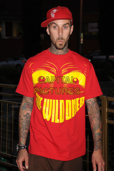 TRAVIS BARKER.LG Electronics Launches the Scarlet HD TV Series at the Pacific Design Center, West Hollywood, California, USA..April 28th, 2008.half length red baseball cap hat tattoos beard facial hair the wild ones yellow print t-shirt funny face .CAP/ADM/BP.©Byron Purvis/AdMedia/Capital Pictures.
