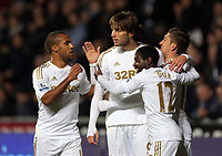 Sunday, 28 November 2012<br /> Pictured: Michu of Swansea (2nd L) celebrating his opening goal with team mates L-R Wayne Routledge, Nathan Dyer and Pablo Hernandez.<br /> Re: Barclays Premier League, Swansea City FC v West Bromwich Albion at the Liberty Stadium, south Wales.