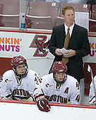 Carl Sneep 7, Mike Brennan 4 and Assistant Coach Greg Brown watch play. The Eagles of Boston College defeated the Falcons of Bowling Green State University 5-1 on Saturday, October 21, 2006, at Kelley Rink of Conte Forum in Chestnut Hill, Massachusetts.<br />