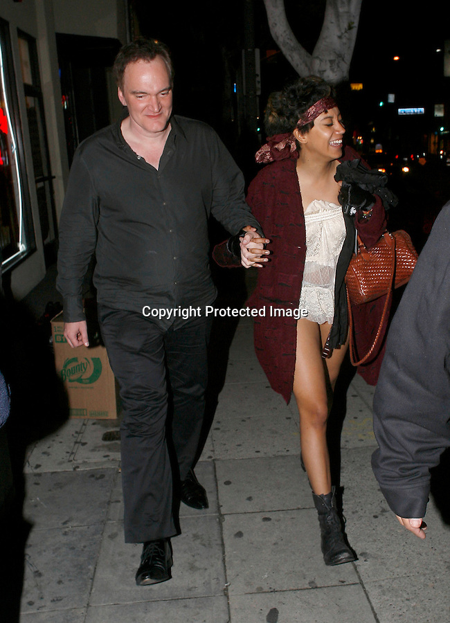 .4-21-2010. Exclusive..Quentin Tarantino & his new girlfriend leaving the Roxy theatre in Hollywood. The couple watched a band called Semi Precious Weapons play. The singer Kesha also attended the concert & fell outside the club.  Quentin was very sweaty ...AbilityFilms@yahoo.com.805-427-3519.www.AbilityFilms.com