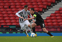 Scott Brown closed down by Graham Carey in the St Mirren v Celtic Scottish Communities League Cup Semi Final match played at Hampden Park, Glasgow on 27.1.13.