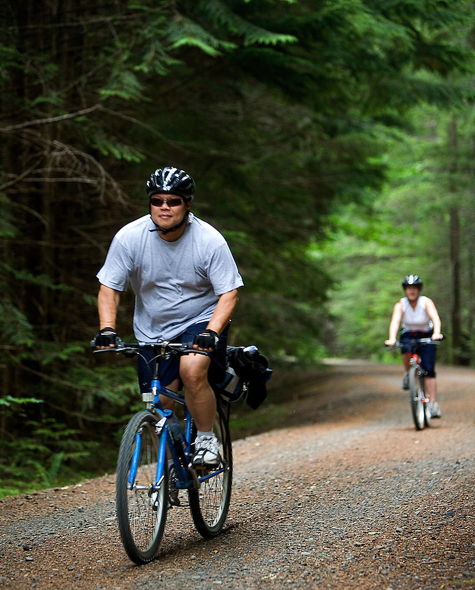 Photo by Stephen Brashear.Richard Chou of Kirkland Wash.,  and Cynthia McMath of Lynnwood, Wash., make their way down the John Wayne Pioneer trail between Hyak, Wash., and Rattlesnake Lake near North Bend, Wash., Sunday Aug. 17, 2008.