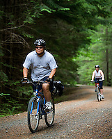 Photo by Stephen Brashear.Richard Chou of Kirkland Wash.,  and Cynthia McMath of Lynnwood, Wash., make their way down the John Wayne Pioneer trail between Hyak, Wash., and Rattlesnake Lake near North Bend, Wash., Sunday Aug. 17, 2008.