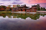 Peaceful autumn scenery of the Phoenix Hall, Amida hall of Byodoin temple on Kojima island of Jodoshiki teien, Pure Land garden pond. Uji, Kyoto Prefecture, Japan 2017