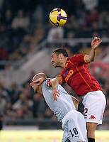 Calcio, Serie A: Roma vs Lazio. Roma, stadio Olimpico, 16 novembre 2008. .Football, Italian serie A: Roma vs Lazio. Rome, Olympic stadium, 16 november 2008..Lazio forward Tommaso Rocchi and AS Roma defender Max Tonetto, right, jump for the ball..UPDATE IMAGES PRESS/Riccardo De Luca