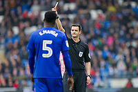 Referee Andy Madley shows a yellow card to Bruno Manga of Cardiff City during the Sky Bet Championship match between Cardiff City and Sunderland at the Cardiff City Stadium, Cardiff, Wales on 13 January 2018. Photo by Mark  Hawkins / PRiME Media Images.