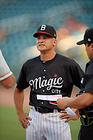 Birmingham Barons manager Omar Vizquel (13) during the lineup exchange before a Southern League game against the Chattanooga Lookouts on July 24, 2019 at Regions Field in Birmingham, Alabama.  Chattanooga defeated Birmingham 9-1.  (Mike Janes/Four Seam Images)