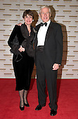 "Frederic V. Malek and his wife, Marlene, arrive at the Harry S. Truman Building (Department of State) in Washington, D.C. on December 4, 2004 for a dinner hosted by United States Secretary of State Colin Powell.  At the dinner six performing arts legends will receive the Kennedy Center Honors of 2004.  This is the 27th year that the honors have been bestowed on ""extraordinary individuals whose unique and abundant artistry has contributed significantly to the cultural life of our nation and the world"" said John F. Kennedy Center for the Performing Arts Chairman Stephen A. Schwarzman.  The award recipients are: actor, director, producer, and writer Warren Beatty; husband-and-wife actors, writers and producers Ossie Davis and Ruby Dee; singer and composer Elton John; soprano Joan Sutherland; and composer and conductor John Williams.<br /> Credit: Ron Sachs / CNP"