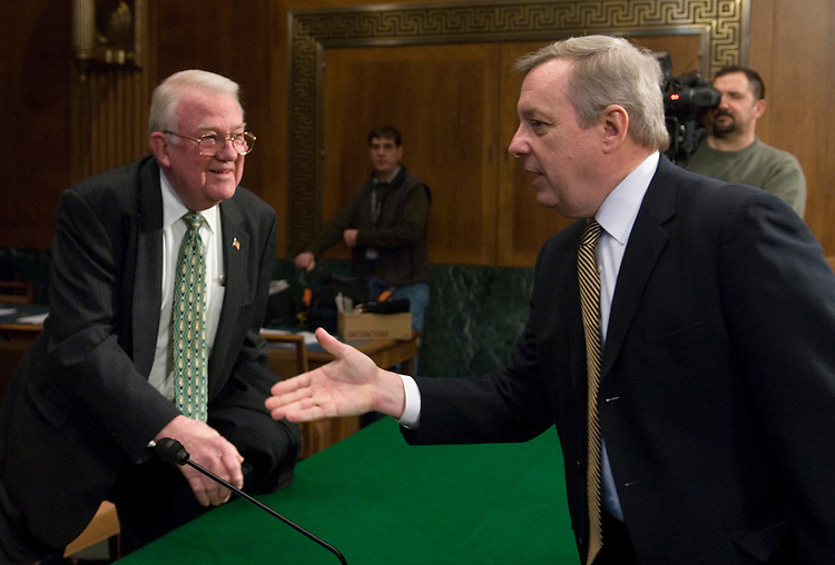 Sen. Dick Durbin, D-Ill., greets former Attorney General Edwin Meese, left, member of the Iraq Study Group, before the start of the Senate Judiciary Committee hearing on improving Iraq's judicial system on Wednesday, Jan. 31, 2007.