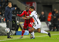 29th November 2019; Liberty Stadium, Swansea, Glamorgan, Wales; English Football League Championship, Swansea City versus Fulham; Aboubakar Kamara of Fulham and Kyle Naughton of Swansea City jostle for the ball - Strictly Editorial Use Only. No use with unauthorized audio, video, data, fixture lists, club/league logos or 'live' services. Online in-match use limited to 120 images, no video emulation. No use in betting, games or single club/league/player publications