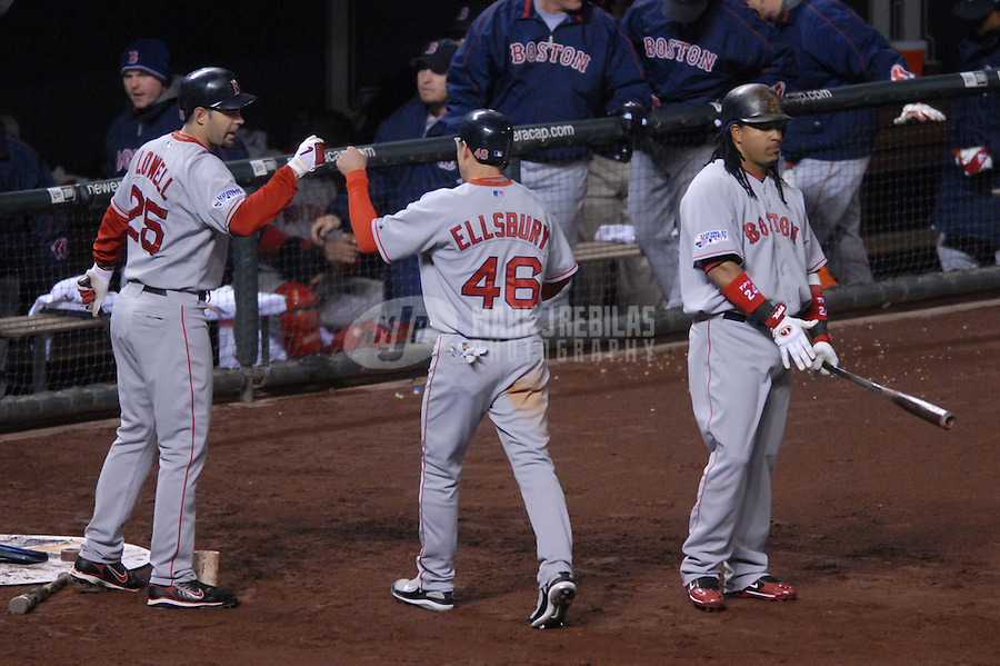 Oct 27, 2007; Denver, CO, USA; Boston Red Sox center fielder (46) Jacoby Ellsbury is congratulated by third baseman (25) Mike Lowell after scoring against the Colorado Rockies during game 3 of the 2007 World Series at Coors Field. Mandatory Credit: Mark J. Rebilas-US PRESSWIRE
