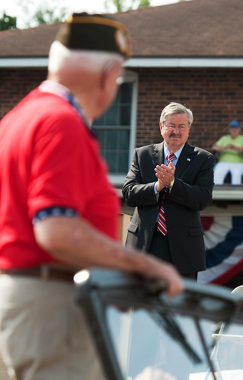 UNITED STATES - AUGUST 15:  Rep. Leonard Boswell, D-Iowa, a Vietnam veteran, is applauded by Iowa Gov. Terry Branstad (R) during a Veteran's parade at the Iowa State Fair in Des Moines, Iowa.  (Photo By Tom Williams/Roll Call)