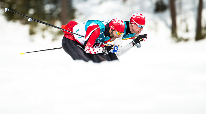 PyeongChang 9/3/2018 - Brian McKeever, of Canmore, AB, and .Mark Arendz, of Hartsville, PEI, during a biathlon/cross country training session at the Alpensia Biathlon Centre during the 2018 Winter Paralympic Games in Pyeongchang, Korea. Photo: Dave Holland/Canadian Paralympic Committee