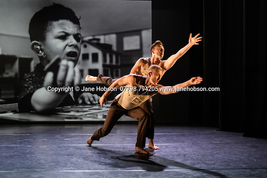"""London, UK. 09.10.19. Deaf Men Dancing present """"Time"""", a triple bill of work, comprising """"Hear! Hear!"""", """"TEN"""" and """"The Progress Score"""", as part of Greenwich Performs, at Laban Theatre, Greenwich, on the 9th and 10th October. The piece shown is: """"Hear! Hear"""", based on the original choreography by Mark Smith, new version re-created & re-imagined by Joseph Fletcher. Lighting design is by Jonathan Samuels, with costume and projection design by Ryan Dawson Laight. <br /> The dancers are: Aaron Rahn, Joe Porton, Joshua Kyle-Cantrill & Joseph Fletcher."""