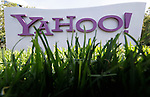 FILE - In this May 20, 2012 file photo, a Yahoo sign stands outside the company's offices in Santa Clara, Calif.  Yahoo turned in another lackluster performance in the second quarter announce the company on Tuesday, July 17, 2012. The results underscore the challenges facing Yahoo's newly hired CEO Marissa Mayer as she tries to turn around the Internet company after a 13-year career as a top Google executive. (AP Photo/Paul Sakuma, File)