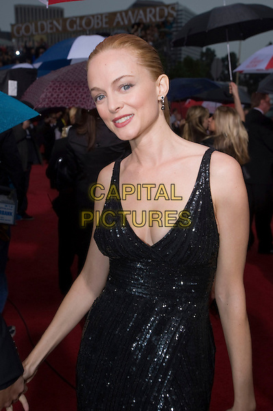 HEATHER GRAHAM.Arrivals at the 67th Golden Globe Awards held Beverly Hilton, Beverly Hills, California, USA..January 17th, 2010.globes half length black beaded cleavage sparkly sequin sequined dress .CAP/AW/HFPA.Supplied by Anita Weber/Capital Pictures