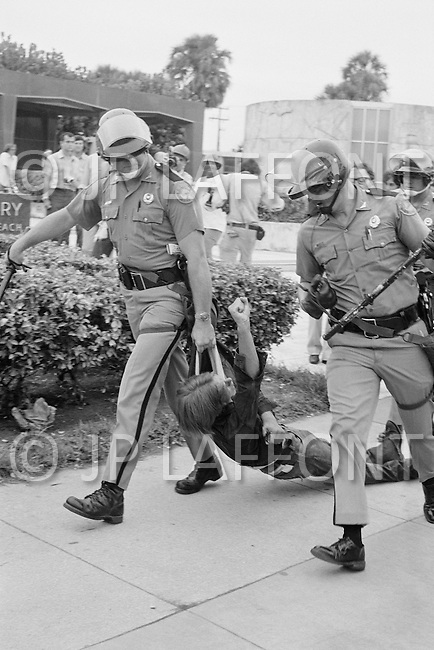 23 Aug 1972, Miami, Florida, USA --- Outside of the 1972 30th Republican Convention, police arrest 1000 demonstrators attempting to disrupt the event. Several thousand Women's Lib protesters demonstrate, led by Jane Fonda, were joined by the Vietnam Veterans to speak out against the war. --- Image by © JP Laffont