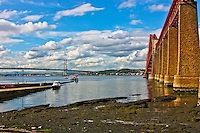 Looking across the river in South Queensferry Scotland at the Firth of Forth Bridges