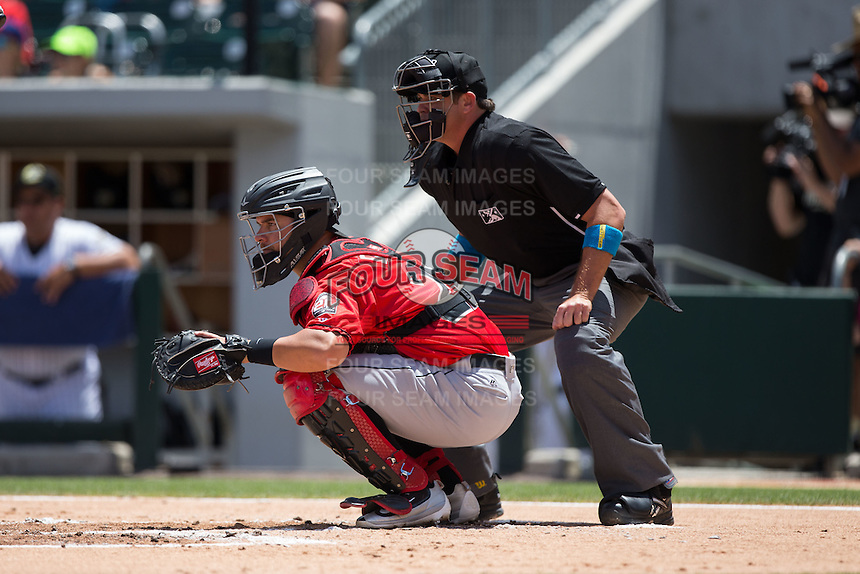 Indianapolis Indians catcher Ed Easley (22) sets a target as home plate umpire Ryan Additon looks on during the game against the Charlotte Knights at BB&T BallPark on June 19, 2016 in Charlotte, North Carolina.  The Indians defeated the Knights 6-3.  (Brian Westerholt/Four Seam Images)