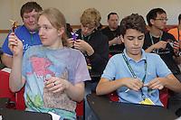 OrigamiUSA 2016 Convention at St. John's University, Queens, New York, USA. Rowan Pierick (l), Wisconsin, and Tristan Saidi (r), New Jersey, fold in Kade Chan's Capricorn class.