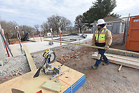 NWA Democrat-Gazette/FLIP PUTTHOFF <br />PEA RIDGE SPLASH PARK<br />Dean De Candia (cq) works Wednesday Nov. 28 2019 on a splash park being built at Pea Ridge Citiy Park. The splash park will have 20 nozzles, water features and showers, said Rick Campbell with Ellington Contracting. The park will be ready to open in the spring.