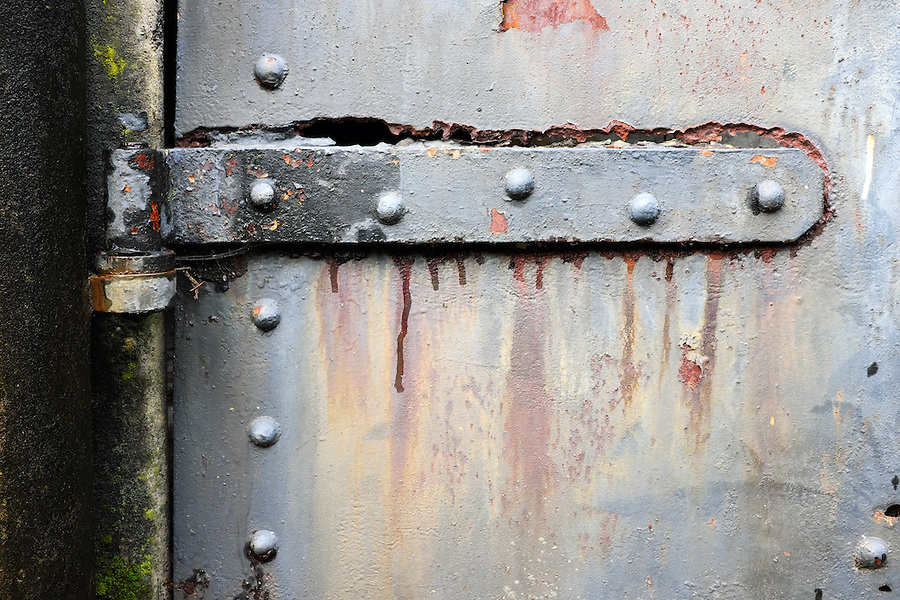 Rusty steel hinch on steel bunker tunnel door, Artillery Hill, Fort Worden State Park, Port Townsend, Washington, USA