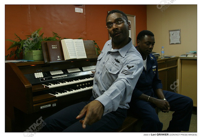 Choir trainer YNY  (Yoeman) Frederick Moses. USNS COMFORT Naval hospital ship in the Persian Gulf.