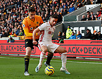 George Baldock of Sheffield Utd and Max Kilman of Wolves during the Premier League match at Molineux, Wolverhampton. Picture date: 1st December 2019. Picture credit should read: Simon Bellis/Sportimage