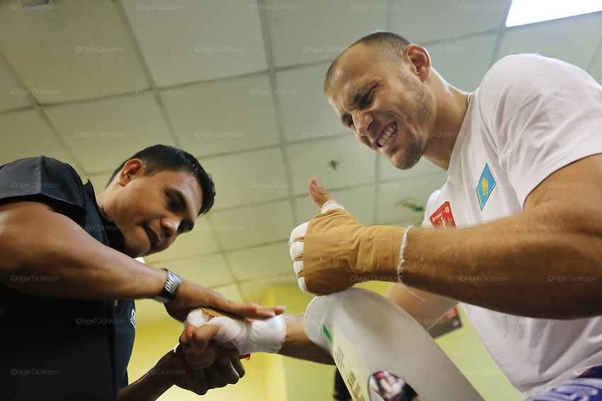 Igor Svirid, One middleweight world champion from Kazakstan in Red locker room getting hands bandaged and practicing before fight<br /><br />MMA. Mixed Martial Arts &quot;Tigers of Asia&quot; cage fighting competition. Top professional male and female fighters from across Asia, Russia, Australia, Malaysia, Japan and the Philippines come together to fight. This tournament takes place in front of a ten thousand strong crowd of supporters in Pelaing Stadium. Kuala Lumpur, Malaysia. October 2015