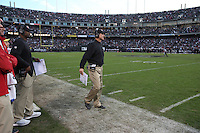 OAKLAND, CA - DECEMBER 7:  Head football coach Jim Harbaugh of the San Francisco 49ers coaches his team from the sidelines during the game against the Oakland Raiders at O.co Coliseum on Sunday, December 7, 2014 in Oakland, California. (Photo by Brad Mangin)