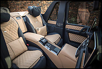 BNPS.co.uk (01202 558833)Pic: Bonhams/BNPS<br /> <br /> Luxury interior of the Mercedes' 'G-class' Maybach G650.<br /> <br /> A limited edition Mercedes G-class has sold for a massive &pound;1.2m at auction - a world record for the footballers favourite.<br /> <br /> The Mercedes-Maybach G650 Landaulet, is one of 99 to be made and sold for more than double the list price of &euro;630,000 (Around 563,000).<br /> <br /> The height of luxury, features include heated cup holders, massage chairs, individual fully-reclinable seats and a partition between driver and passengers which goes from clear to opaque in seconds.<br /> <br /> It also has a canvas roof which opens at the touch of a button, fold-out leather tables, silver champagne flutes and state of the art entertainment systems.