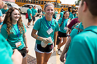 "Katy Spencer, center, socializes with fellow members during ""Circle the City with Service,"" the Kiwanis Circle K International's 2015 Large Scale Service Project, on Wednesday, June 24, 2015, in Indianapolis. (Photo by James Brosher)"