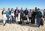 John Meehan and son Luke, 10, (4th from L) Area Manager, External Affairs for Jersey Central Power & Light and Mark Jones, JCP&L Vice President of Operations (5th from L) join Point Pleasant Beach, NJ Mayor Stephen D. Reid (C) with volunteers at the JCP&L sponsored Beach Sweep in Point Pleasant Beach, New Jersey 10/21/17.
