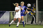 7 November 2007: Duke's Kelly McCann (18) plays the ball against Wake Forest's Amy Smerdzinski (21). Wake Forest University defeated Duke University 1-0 in overtime at the Disney Wide World of Sports complex in Orlando, FL in an Atlantic Coast Conference tournament quarterfinal match.