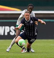 Tina Ellertson, Abby Wambach. The Washington Freedom defeated the Saint Louis Athletica, 3-1.