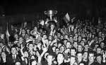 Kerry captain Mickey Joe Lyne holds the Sam maguire cup aloft after the team's homecoming at Killarney railway Station after the 1955 All-Ireland Football final..Photo by Donal MacMonagle..from the MacMonagle, Killarney photo archive.www.macmonagle.com