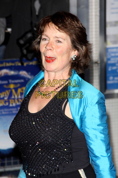 "CELIA IMRIE.The World Premiere of ""Nanny McPhee & The Big Bang"", Odeon West End, London, England..24th March 2010.half length blue shiny turquoise bolero cropped shrug jacket black beaded vest top skirt gold stripe tongue mouth open funny .CAP/AH.©Adam Houghton/Capital Pictures."