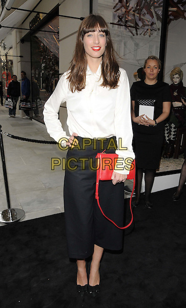 Laura Jackson<br /> attended the Chanel new flagship boutique launch party, Chanel, New Bond St., London, England.<br /> June 10th, 2013<br /> full length white shirt cropped black trousers red clutch bag hand on hip<br /> CAP/CAN<br /> &copy;Can Nguyen/Capital Pictures