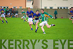 Chris O'Leary of the Sem get the ball away as Kieran O'Mahony makes a go in stopping him from kicking it  in the O'Sullivan Cup on Wednesday in KOR Pat Healy Memorial Park, Ballyrickard, Tralee.