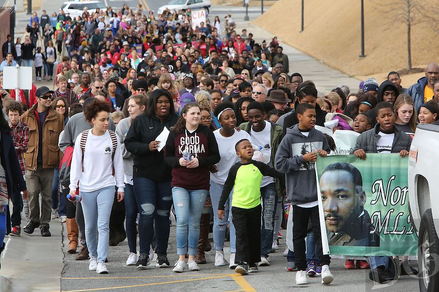 NWA Democrat-Gazette/DAVID GOTTSCHALK   Marchers participate Monday, January 16, 2017, in the annual Martin Luther King Jr. Freedom March to the campus of the University of Arkansas in Fayetteville. Participants in the march began near the corner of Razorback Road and Martin Luther King, Jr. Boulevard and marched, sang and chanted to the Arkansas Union for the Martin Luther King, Jr. Vigil co-sponsored by the University of Arkansas Associated Student Government, the Black Student Association and the Northwest Arkansas Martin Luther King, Jr. Council.