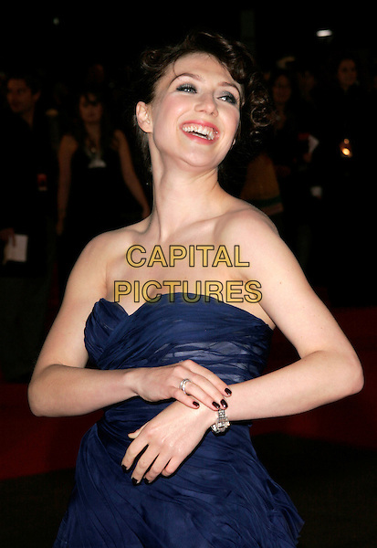 "CARICE VAN HOUTEN.At the UK Film Premiere of ""Valkyrie"", Odeon Leicester Square, London, England, January 21st 2009..half length strapless ink blue chiffon dress hand arm touching bracelet .CAP/AH.©Adam Houghton/Capital Pictures"