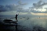 Seaweed harvester at dawn on the island of Nusa Lembogan near Bali, Indonesia.  CD scan from 35mm film.  © John Birchard