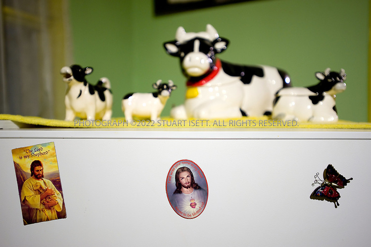 12/12/2008--Seattle, WA, USA..Fridge magnets and cows that belonged to Edith Macefield (born in 1921 in Oregon. Died June 15, 2008 Seattle, Washington) in the kitchen table of her small home in Seattle, WASH . Macefield achieved worldwide fame in 2006 when she refused US$1 million offered to her by developers to sell her home (shown here) to make way for a commercial development in the Ballard neighborhood of Seattle. Instead, the five-story project was built around her 108-year-old farmhouse, where she passed away at age 86...Barry Martin, senior superintendent for Ledcor Construction, who are building the project around the house, befriended Macefield and in her last year visited regularly to cook meals and shop. With no surviving family, Macefield willed the house to Martin when she died on June 15th, 2008. Martin has not touch anything in the house, leaving everything exactly as it was the day Macefield died...©2008 Stuart Isett. All rights reserved.
